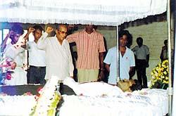 Bernard Soysa saluting a fallen hero
